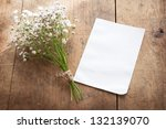 bouquet of baby's breath (or Gypsophila), with blank memo paper by a natural sunlight window. - stock photo