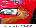hand with a wipe the car... | Shutterstock . vector #132141383
