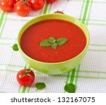 Traditional hot fresh diet tomato soup with basil - stock photo