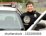 A Female Police Officer Smilin...
