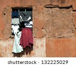 old red house in Jaipur,India and clothes on the window - stock photo