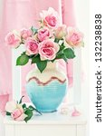 Beautiful fresh roses in a ceramic vase. - stock photo