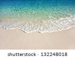 Wave of the sea on the sand beach - stock photo