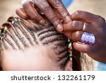 Young girl when creating a new hairstyle - stock photo
