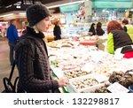 Young Woman Choosing Seafood O...