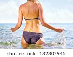 Beautiful female body on the beach. - stock photo