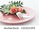table setting with roses - stock photo