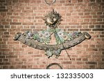 Sundial On A Brick Wall Of A...