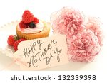 homemade strawberry cup cake with elegant carnation flower for mother's day image - stock photo