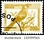 "Small photo of REPUBLIC OF BENIN - CIRCA 2000: A stamp from Benin (formerly Dahomey) shows image of Lucinia megarhynchos bird, with the same inscription, from the series ""Birds"", circa 2000"