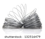 Coil of galvanized wires on white background - stock photo