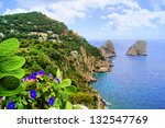 Famous Faraglioni rocks off the island of Capri, Italy - stock photo