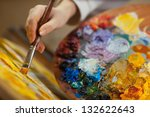 Artist Paints A Picture Of Oil...