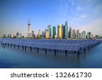 Shanghai Bund skyline landmark ,Ecological energy renewable solar panel plant - stock photo