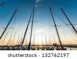 Sailing boats in the harbor at summer - stock photo