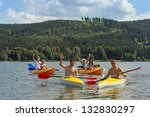 Young Kayaking Friends Having...
