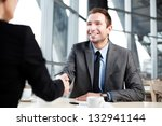 Happy businessman shaking hand with businesswoman. - stock photo