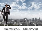 businessman with binoculars... | Shutterstock . vector #133009793