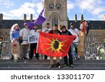 OTTAWA, CANADA - MAR 25:  A group of Cree youth that walked 1600 kilometers to bring attention aboriginal issues on March 25, 2013 at Parliament Hill in Ottawa, Ontario - stock photo