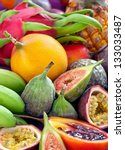 Fruit background .Mix of many fresh tropical fruits . - stock photo