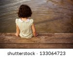 Lone Little Girl Sitting On Pier