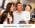shopping family looking very... | Shutterstock . vector #133079117