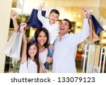 excited shopping family with... | Shutterstock . vector #133079123