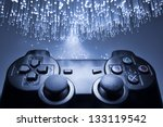 Game controller and blue light - stock photo