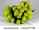Branch of green grapes isolated on white - stock photo