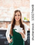 Waitress serving coffee - stock photo