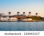 A number of mills on the hill near the sea on the island of Mykonos in Greece - the main attraction of the island - stock photo
