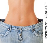 woman shows her weight loss by... | Shutterstock . vector #133508447