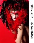 Naked woman in venetian mask over red - stock photo