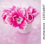 pink tulips in a ceramic vase. - stock photo