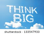 Small photo of Think big a cloud massage on sky