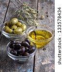 black and green olives on table - stock photo