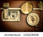 old suitcase  and compass  isolated on white background - stock photo