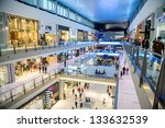 DUBAI, UAE - NOVEMBER 14: Shoppers at Dubai Mall on Nov 14, 2012 in Dubai. At over 12 million sq ft, it is the world's largest shopping mall based on total area and 6th largest by gross leasable area. - stock photo