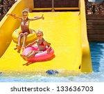 child on water slide at... | Shutterstock . vector #133636703