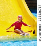 child on water slide at... | Shutterstock . vector #133636787