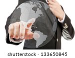Businessman pushing World Map Globe for Business and Technology Concept. - stock photo