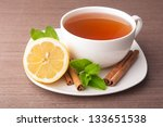 Cup of tea with lemon and mint on background - stock photo