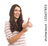businesswoman holding thumb up | Shutterstock . vector #133657853