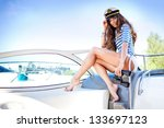 attractive girl on a yacht at... | Shutterstock . vector #133697123