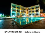 Exterior of a luxury hotel at night - stock photo