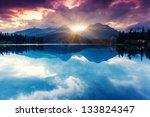 Stock photo mountain lake in national park high tatra dramatic overcast sky strbske pleso slovakia europe 133824347