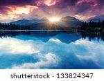 Stock photo mountain lake in national park high tatra dramatic overcast sky strbske pleso slovakia europe 133824347