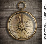 Old Brass Compass On Wood Tabl...