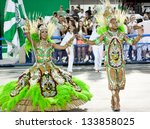 RIO DE JANEIRO - FEBRUARY 10: A woman and men in costume dancing on carnival at Sambodromo in Rio de Janeiro February 10, 2013, Brazil. The Rio Carnival is biggest carnival in world. - stock photo
