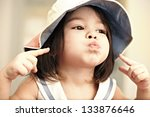 portrait of a beautiful little girl expresses emotions indoor - stock photo